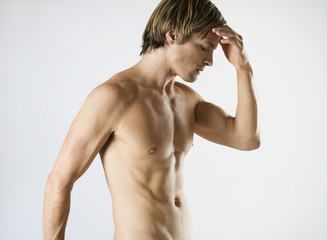A male nude, with a headache