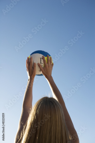 A woman playing beach volleyball