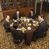 Businesspeople eating. poster