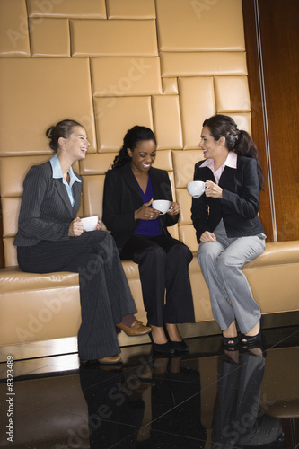 Businesswomen with coffee.