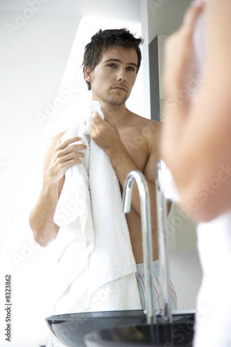 Young man washing in the bathroom