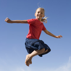 A young girl jumping