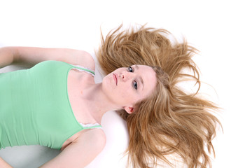 woman on her back with her hair spread out