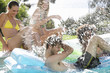 Four teenage friends having fun in a swimming pool