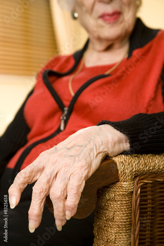 An elderly woman sitting in a chair