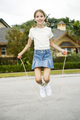 A young girl skipping