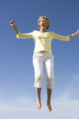 A mature woman jumping
