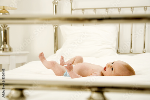 A baby laying on a bed