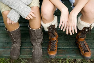 Two teenage girls wearing boots