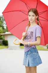 A young girl with an umbrella