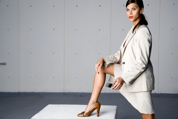 A businesswoman standing on a block