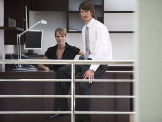 A businessman and woman in the office