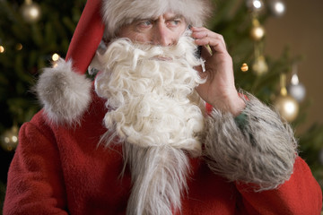 Father Christmas/Santa Claus talking on a mobile phone