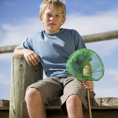 A young boy with a fishing net