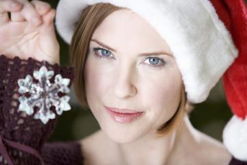 Portrait of a woman wearing Santa's hat