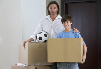 A father and son moving into a new home