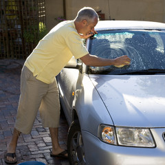 Man washing a car