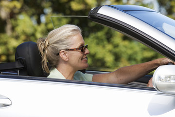 A senior woman driving a car