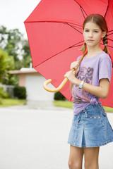 A young girl with an umbrella