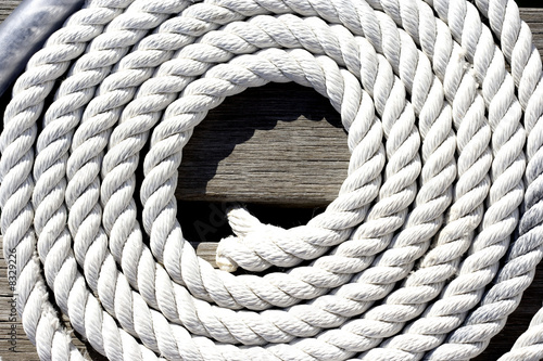 Coiled rope on jetty, close-up