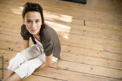 A young woman sitting on the floor
