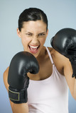 A young woman boxing