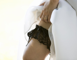 A bride showing her garter