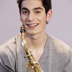 A teenage boy with a saxophone