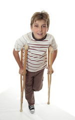 Injured child using crutches