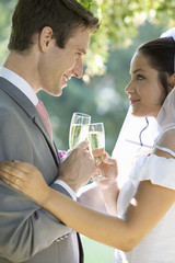 A bride and groom drinking champagne