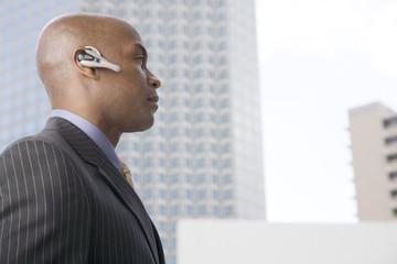 A businessman wearing a bluetooth headset