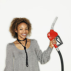 Woman holding gas nozzle