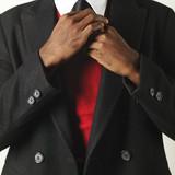 Man fixing necktie poster