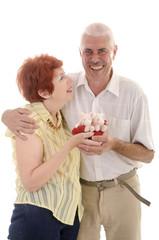 senior couple with toy