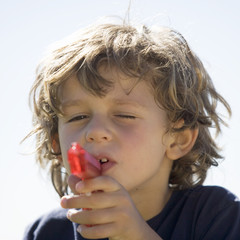 A young boy with a water pistol