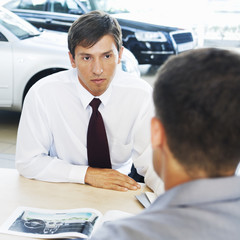 A salesman talking to a customer
