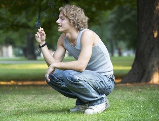 A teenage boy smoking