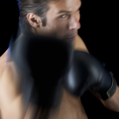 A young man boxing