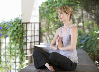 A young woman meditating