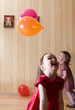 Portrait of two little girls playing with airy balls