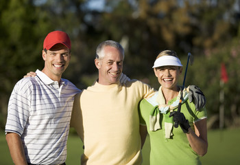 Portrait of three friends on a golf course