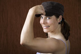 Woman with blue eyes flexing her muscle poster