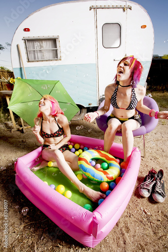 Women in a play pool playing with bubbles