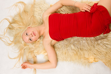 Blonde lying on the fur