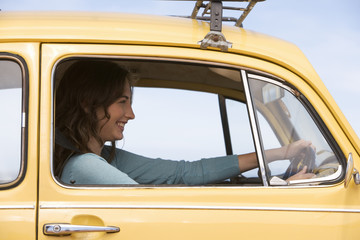 A young woman driving a car
