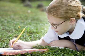 A girl writing in a notebook