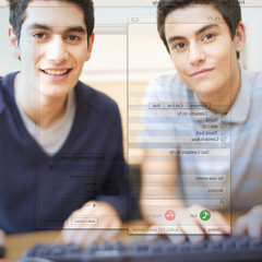 Two teenage boys using a computer