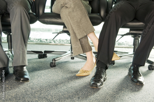 Two colleagues playing footsie