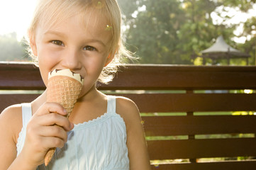 A young girl eating an ice cream