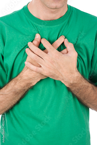 Both man's hands on breast because of hard breathing